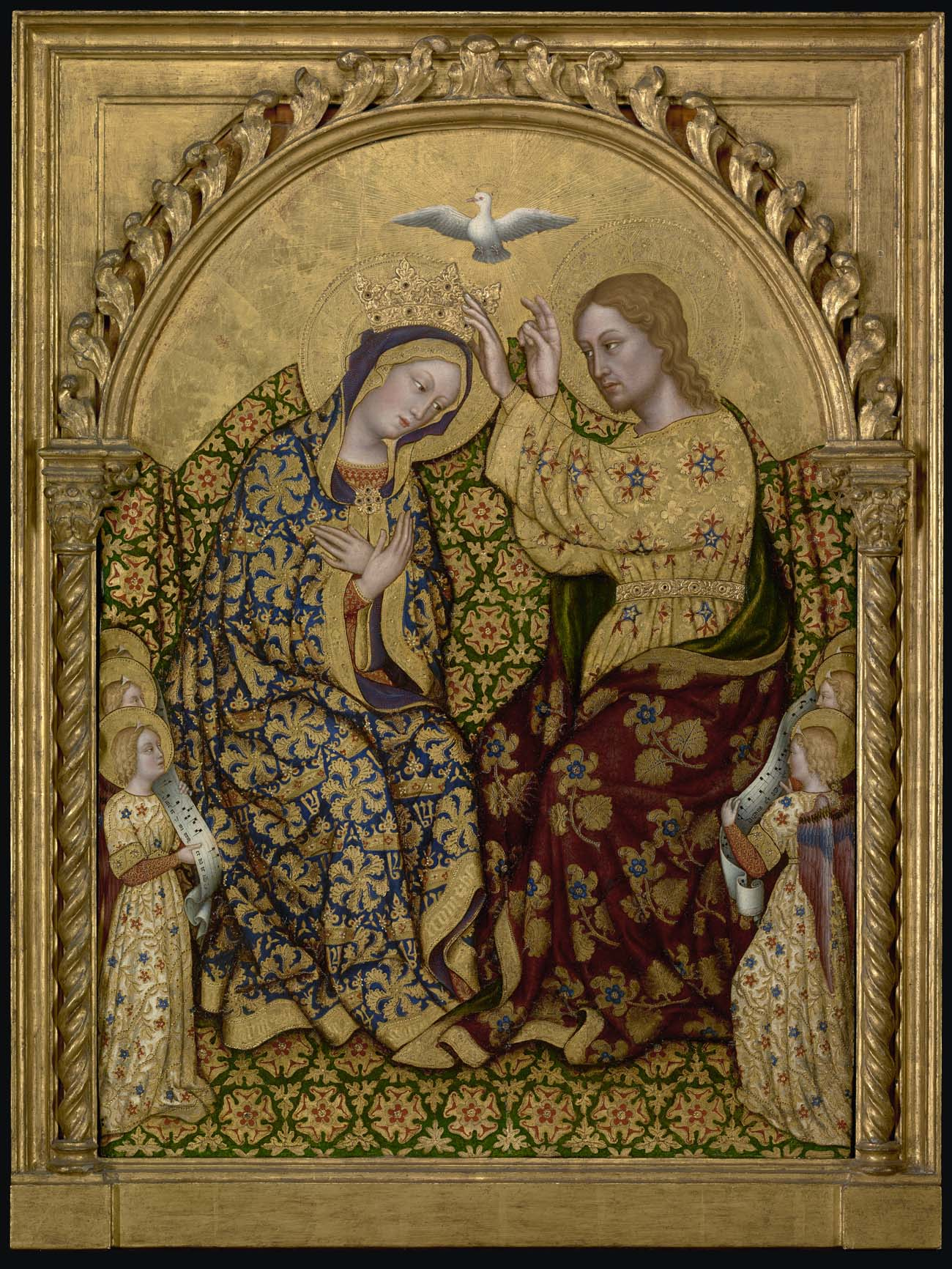 A dove flies above the head of the Virgin Mary in a gilded Renaissance panel painting