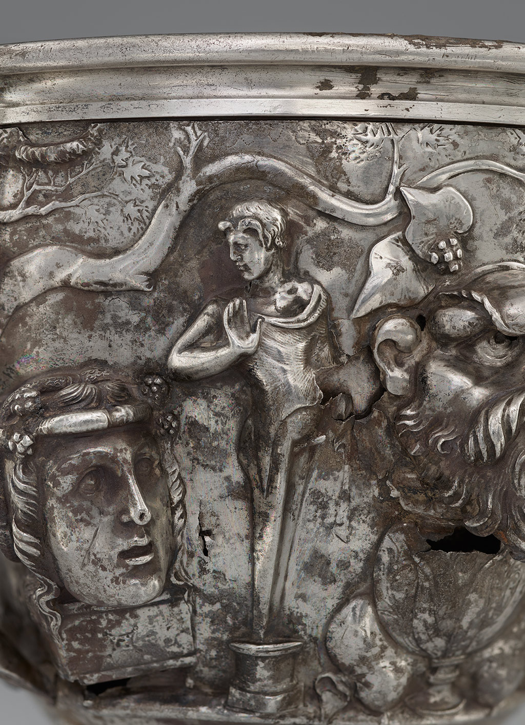 Mercury makes a hand gesture for a mystery cult in on ancient Roman silver cup