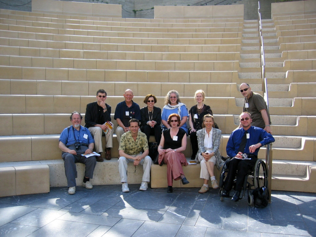 Group of eleven people seated in the lower rows of the Outdoor Classical Theater at the Getty Villa