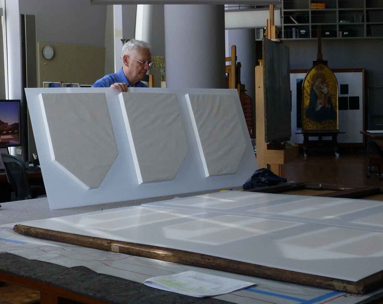 Gene Karraker, frame conservator, preparing the protective inserts which will reduce movement when cleaning the painting.
