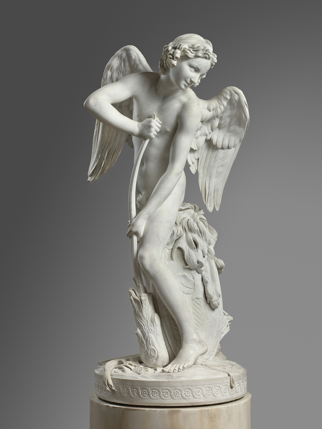 Side view of Edme Bouchardon's marble sculpture of Cupid