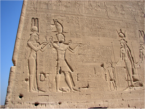 Large-scale inscribed portrait of Queen Cleopatra VII on the side of an Egyptian temple