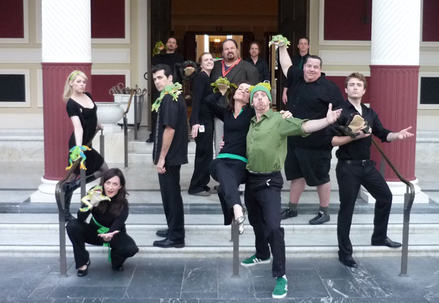 The Troubadors posing in front of the Getty Villa with their fellow frog actors.