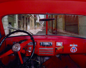 Sol and Cuba, Old Havana, Looking North from Alberto Roja's 1951 Plymouth, Havana, Alex Harris, negative, May 23, 1998; print, December 2007. Chromogenic print, 30 1/8 x 37 3/4 in. The J. Paul Getty Museum, 2010.90.3. Gift of Michael and Jane Wilson, Wilson Centre for Photography © Alex Harris