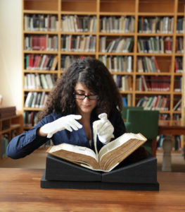 Erene Rafik Morcos documenting the Abbey Bible in the Manuscripts Study Room at the J. Paul Getty Museum