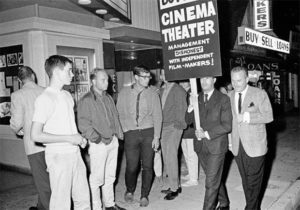 Kenneth Anger and Raymond Rohauer in front of the Cinema Theatre, Los Angeles, 1964