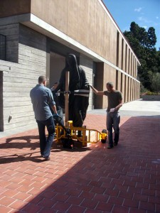 Wheeling the Statue of Tiberius from the loading dock at the Getty VIlla