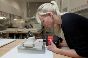 Julia Langenbacher conducts an FTIR analysis of an architectural model of a proposal for Disney Hall