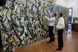 Tom Learner and Alan Phenix of the Getty Conservation Institute with Jackson Pollock's Mural