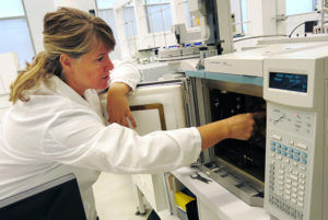 Joy Mazurek of the Getty Conservation Institute with a GC/MS instrument