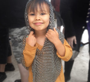 A child dressed in chain mail at a Getty Center family festival