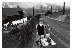 Wales, boy pushing pram / Bruce Davidson