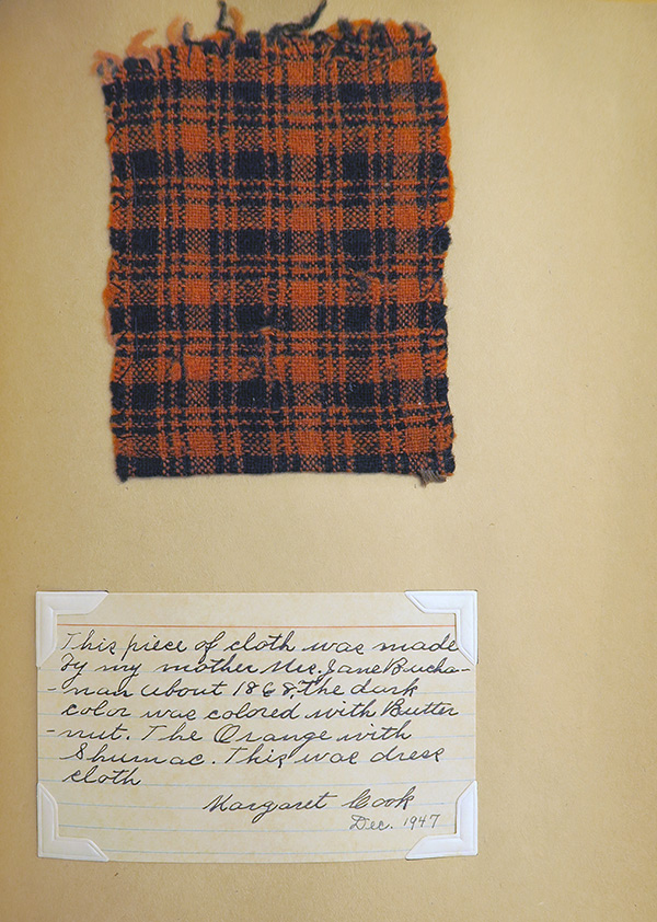 Page from a scrapbook containing textile samples, patterns, and clippings