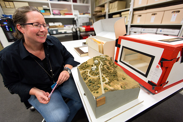 Nancy Enneking, Head of Institutional Archives, reviews an old model of the Getty Center.