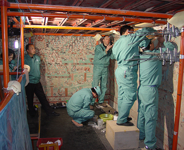 Getty Conservation Institute and Dunhuang Academy conservation team working on the wall paintings in Cave 85