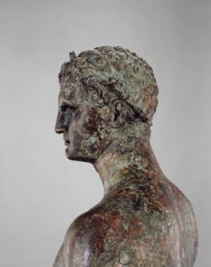 Detail of the face and shoulders of the Statue of a Victorious Youth / Greek